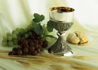 Chalice with grapes and bread representing communion