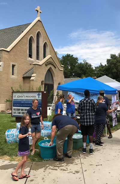 Parishioners handing out water to runners on Pioneer day